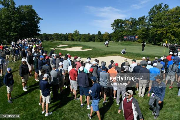 Fans watch the action on the 13th hole as Jordan Spieth Dustin Johnson and Justin Thomas' group passes through during the first round of the Dell...