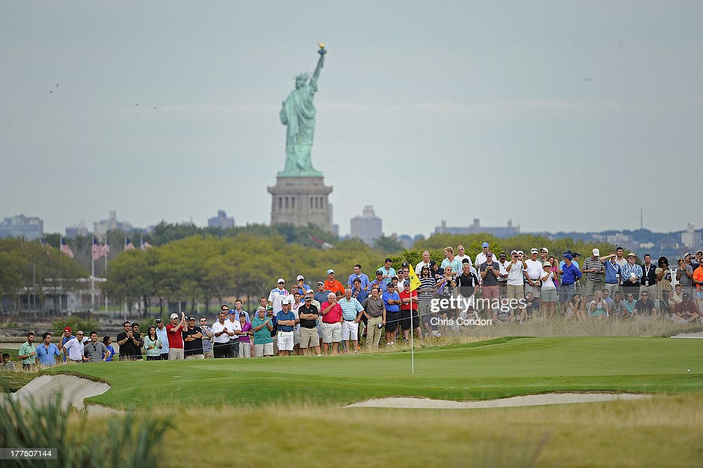 Fans watch the action on the second hole during the second round of The Barclays at Liberty National Golf Club on August 23 2013 in Jersey City New...
