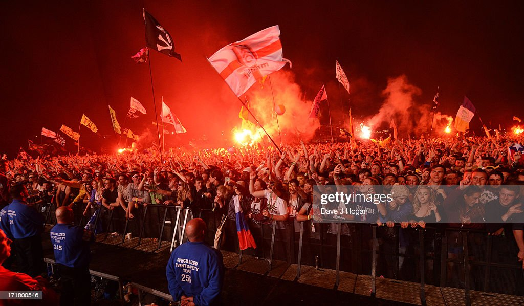 Fans Watch The Arctic Monkeys perform at day 2 of the 2013 Glastonbury Festival at Worthy Farm on June 28, 2013 in Glastonbury, England.