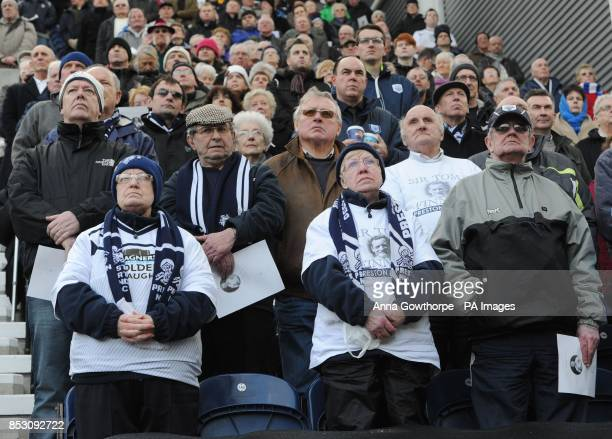 Fans watch the funeral service of Sir Tom Finney on a big screen at Deepdale Preston
