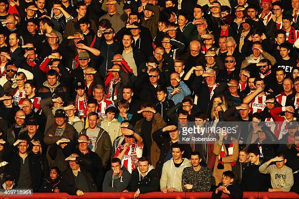 Fans watch the game in the winter sunshine during the Sky Bet Championship match between Brentford and Wolverhampton Wanderers at Griffin Park on...