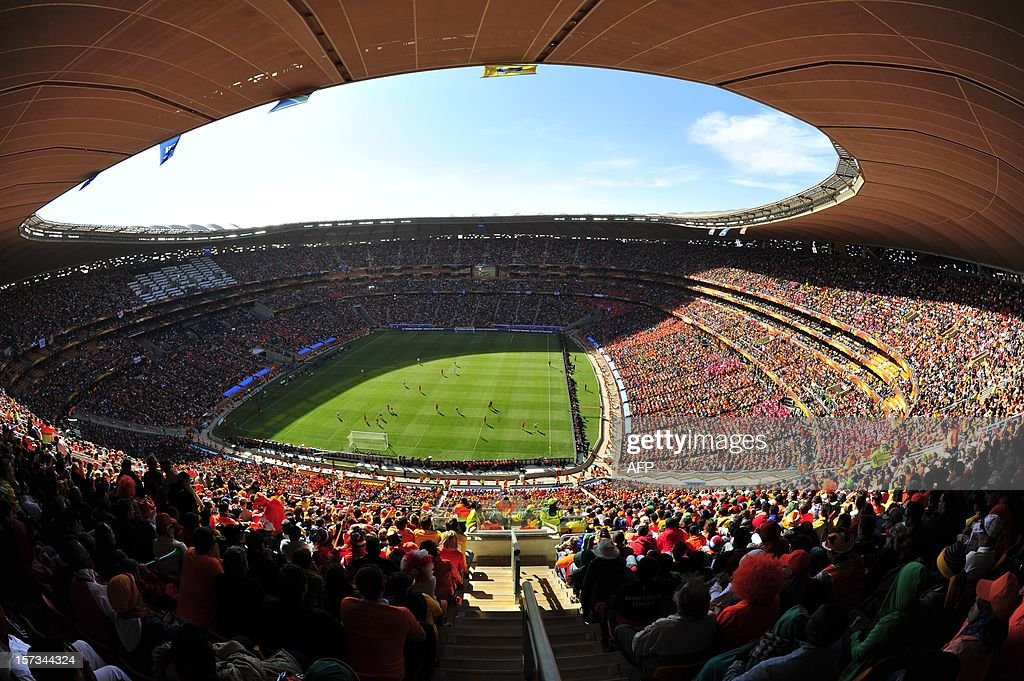 Fans watch the game on June 14, 2010, during the 2010 World Cup match Netherlands and Denmark at Soccer City Stadium in Soweto, suburban Johannesburg. Soccer City stadium outside Johannesburg will be one of the five stadiums to host matches of the 2013 Africa Cup of Nations between January 19 and February 10, 2013. AFP PHOTO / Monirul Bhuiyan