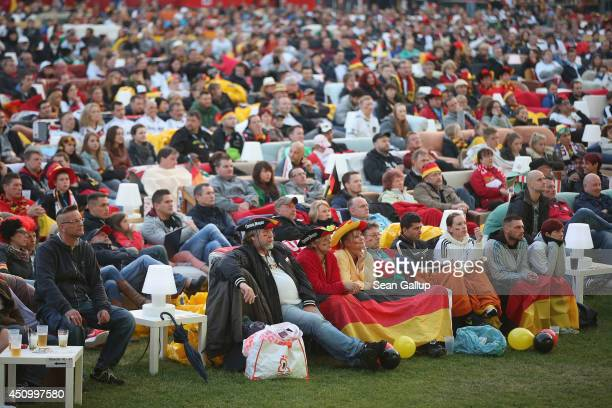 Fans watch the GermanyGhana World Cup match at a public viewing at the Alte Foersterei FC Union stadium on June 21 2014 in Berlin Germany The stadium...