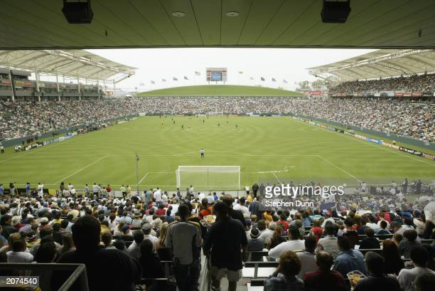 Fans watch the Home Depot Center's inaugural MLS game between the Los Angeles Galaxy and the Colorado Rockies on June 7 2003 in Carson California The...