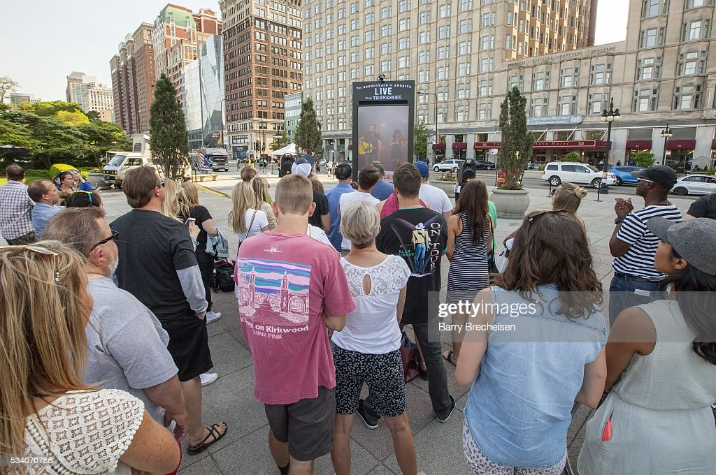 Fans watch the live-stream performance of musical artist Jason Isbell, performing at the Country Music Hall of Fame in Nashville, Tennessee, at Congress Park on May 24, 2016 in Chicago, Illinois.