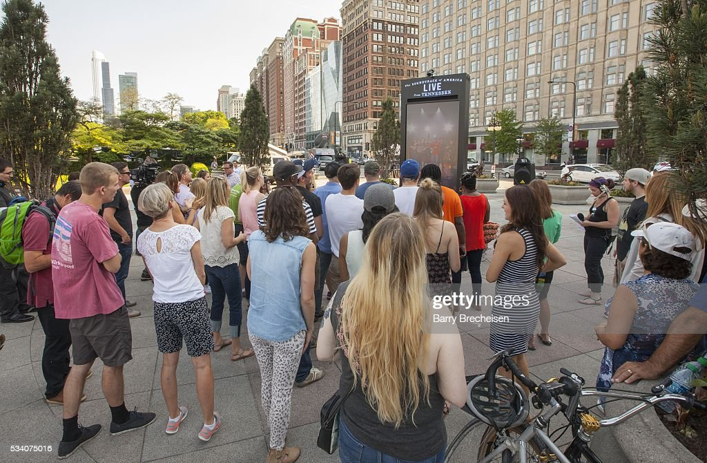 Fans watch the live-stream performance of musical artist Old Crow Medicine Show, performing at the Country Music Hall of Fame in Nashville, Tennessee, at Congress Park on May 24, 2016 in Chicago, Illinois.