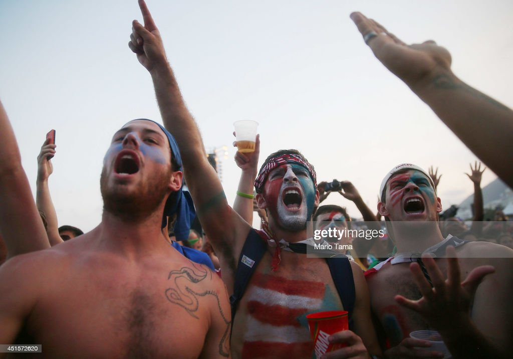 U.S. fans watch the match against Belgium at FIFA Fan Fest on Copacabana Beach on July 1, 2014 in Rio de Janeiro, Brazil. The match is tied 0-0 at halftime.