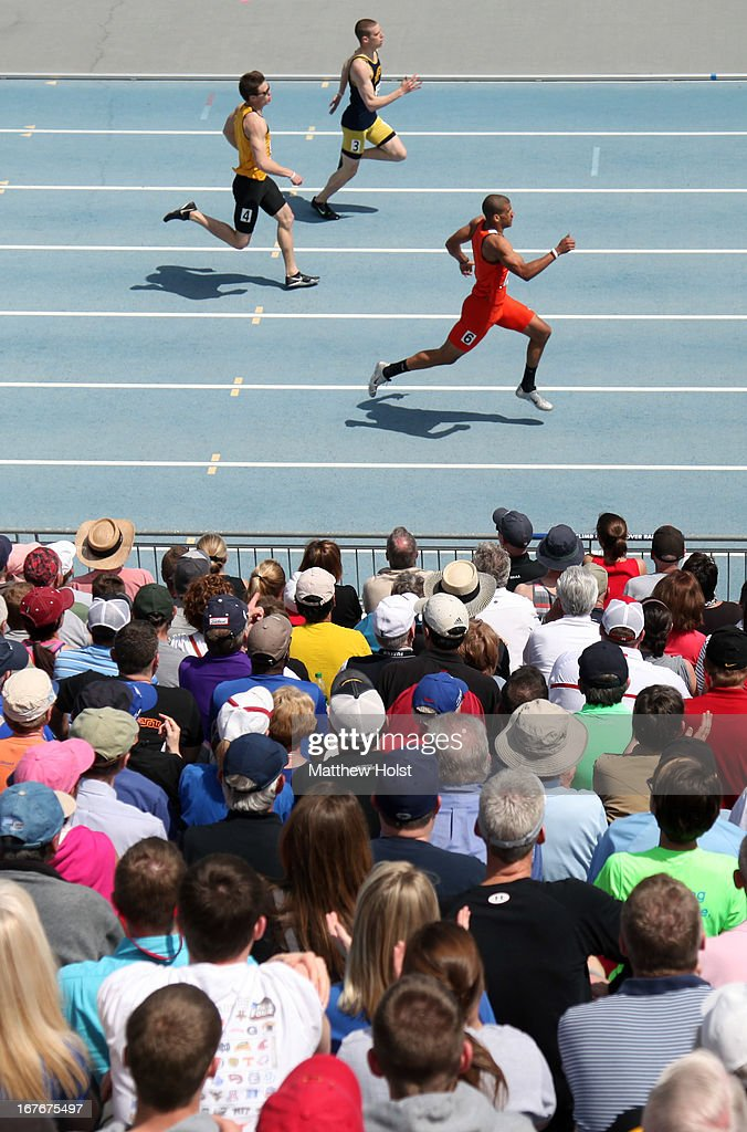 Fans watch the Men's 400-meter Hurdles at the Drake Relays, on April 27, 2013 at Drake Stadium, in Des Moines, Iowa.