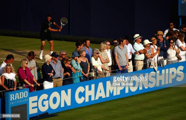 Fans watch the mens doubles match between Jamie Murray of Great Britain Bruno Soares of Brazil and Ryan Harrison of The United States and Michael...