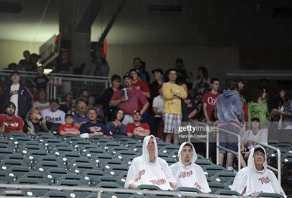 Fans watch the movie 'The Sandlot' on the video board during a rain delay in the seventh inning of the game between the Minnesota Twins and the Boston Red Sox on May 19, 2013 at Target Field in Minneapolis, Minnesota.