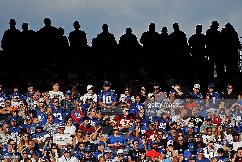 Fans watch the New York Giants and the Washington Redskins at MetLife Stadium on October 21, 2012 in East Rutherford, New Jersey.