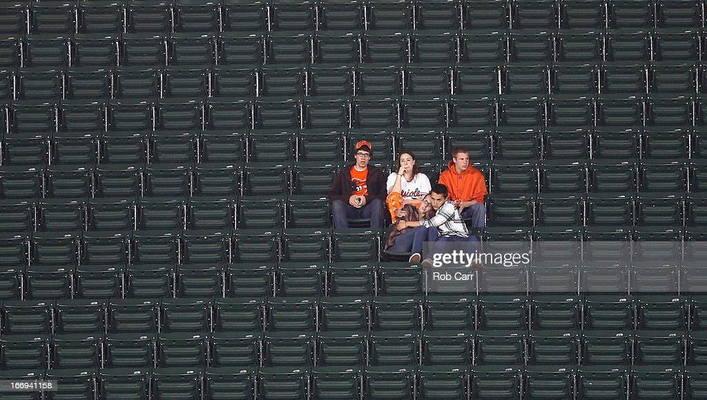 Fans watch the ninth inning of the Baltimore Orioles and Tampa Bay Rays game from the upper deck at Oriole Park at Camden Yards on April 18, 2013 in Baltimore, Maryland.
