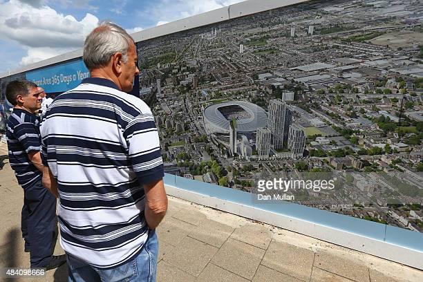 Fans watch the picture of the new stadium plan prior to the Barclays Premier League match between Tottenham Hotspur and Stoke City at White Hart Lane...