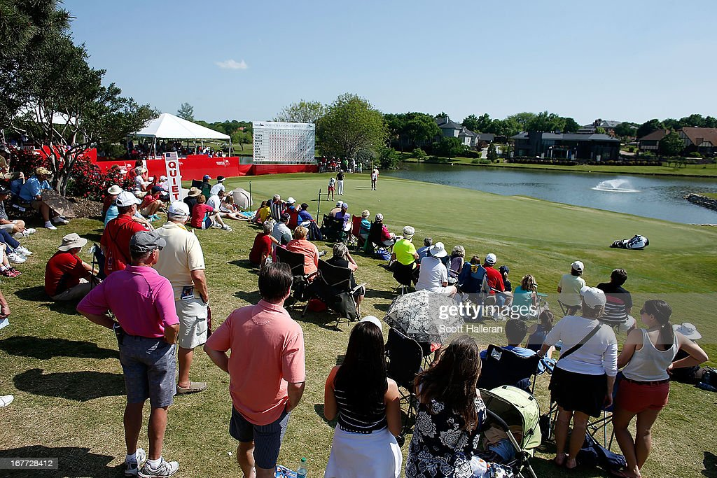 Fans watch the play on the 18th green during the final round of the 2013 North Texas LPGA Shootout at the Las Colinas Counrty Club on April 28, 2013 in Irving, Texas.