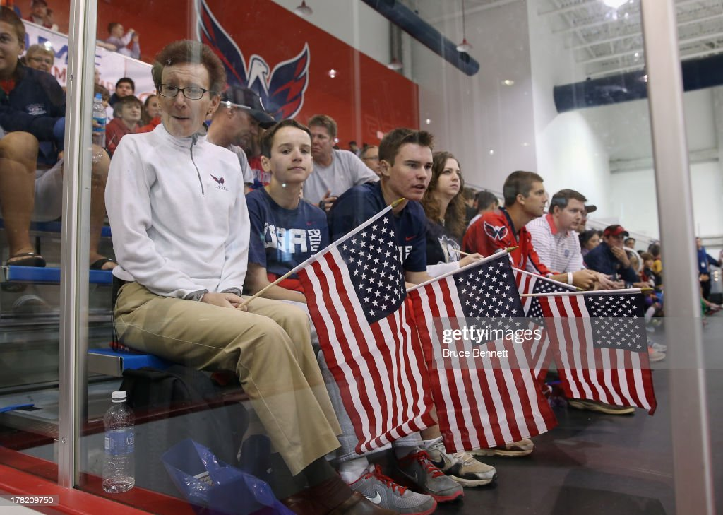 Fans watch the press conference introducing the 2014 USA Hockey Olympic Team candidates at the Kettler Capitals Iceplex on August 27, 2013 in Arlington, Virginia.