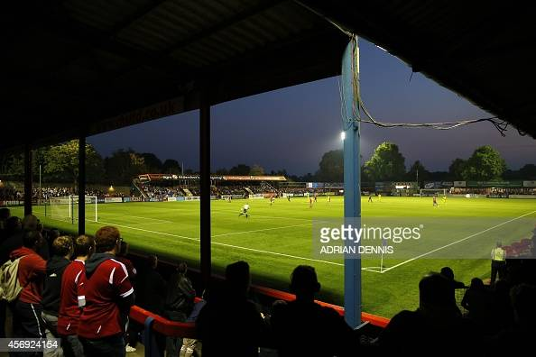 Fans watch the Vanarama Conference local derby football match between Aldershot and Woking at The Electrical Services Stadium in Aldershot on...