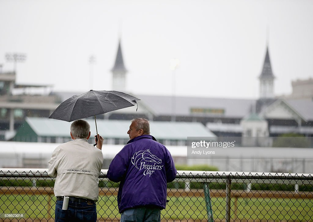 Fans watch the workouts on a rainy morning during the training for the 2016 Kentucky Derby at Churchill Downs on April 30, 2016 in Louisville, Kentucky.