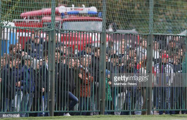 Fans watch through a fence during the UEFA Youth League match between CSKA Moskva U19s and Manchester United U19s at Oktyabr Stadium on September 27...