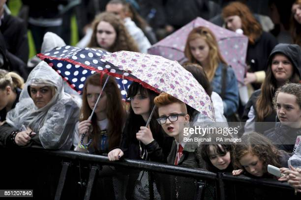 Fans watch Two Door Cinema Club perform onstage at Belfast Botanic Gardens where the Big IF Belfast concert is taking place ahead of the G8 Summit in...