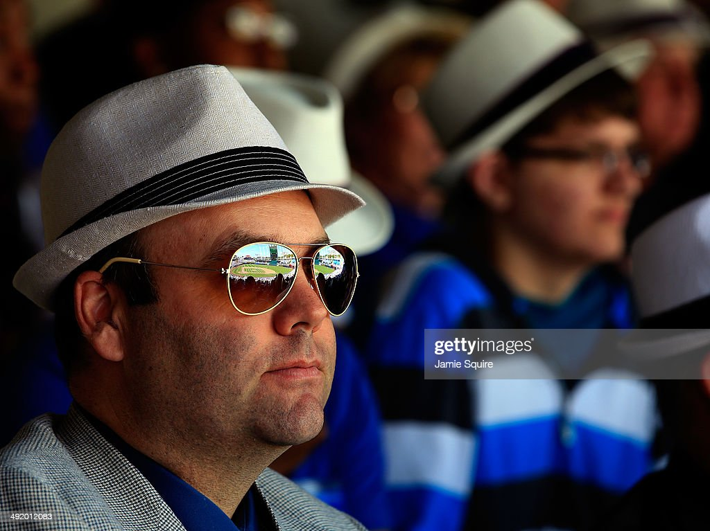 Fans watch while wearing fedoras the team gave away during the game against the Baltimore Orioles at Kauffman Stadium on May 18 2014 in Kansas City...