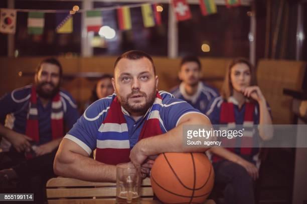 Fans watching basketball