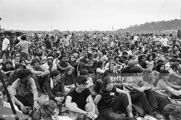 Fans watching first act Richie Havens opening the Woodstock Music Festival Bethel New York 15th August 1969
