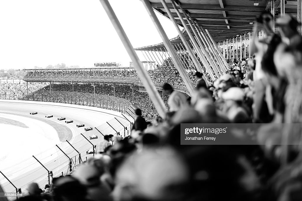 Fans watchthe action during the 100th Running of the Indianapolis 500 Mile Race at Indianapolis Motorspeedway on May 29, 2016 in Indianapolis, Indiana.