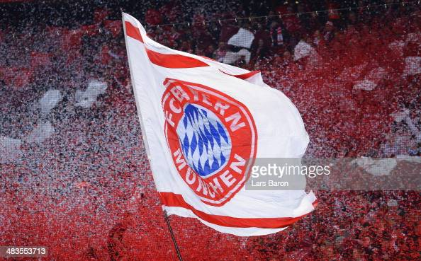 Fans wave a Bayern Muenchen flag during the UEFA Champions League Quarter Final second leg match between FC Bayern Muenchen and Manchester United at...