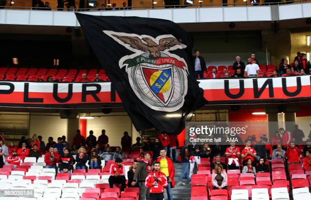 Fans wave a Benfica flag before the UEFA Champions League group A match between SL Benfica and Manchester United at Estadio da Luz on October 18 2017...