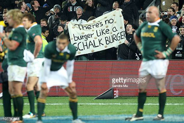 Fans wave a Schalk Burger banner during the TriNations match between the New Zealand All Blacks and South Africa Springboks at Eden Park on July 10...