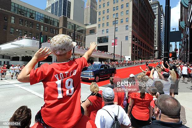 Fans wave as National League AllStar Francisco Rodriquez of the Milwaukee Brewers is driven through the streets of Cincinnati during the AllStar Game...