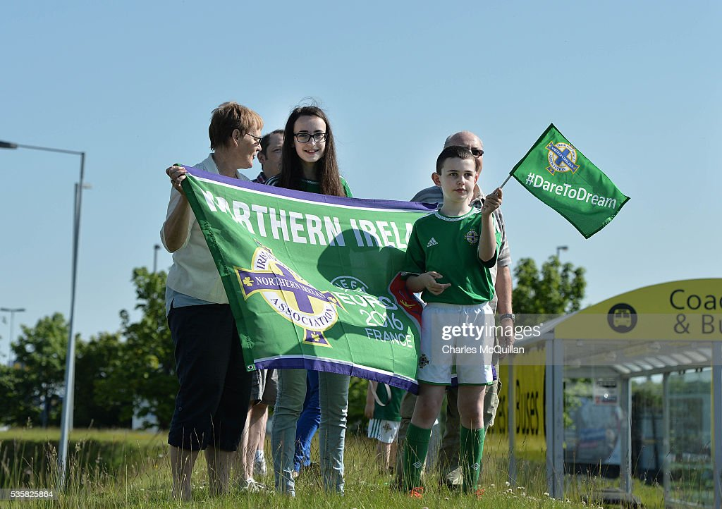 Fans wave as the Northern Ireland football team make their training camp departure at George Best City Airport on May 30, 2016 in Belfast, Northern Ireland. Northern Ireland have qualified for the Euro 2016 football championship finals in France, the first time the province has qualified for an international football tournament final since 1986.