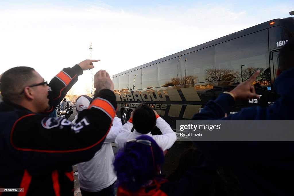 Fans wave at one of the team buses as they pulled into Dove Valley on February 8, 2016 in Centennial, Colorado. Fans cheered for the Denver Broncos when they returned home after defeating the Carolina Panthers to win Super Bowl 50.