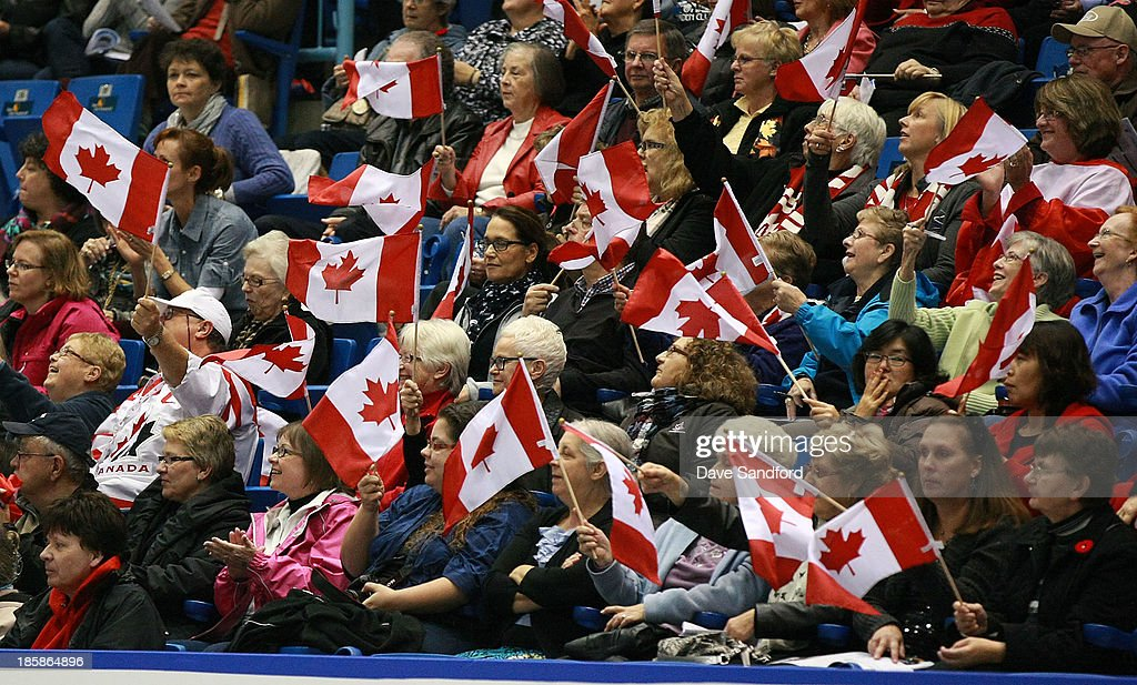 Fans wave Canadian flags during the pairs short program at the ISU GP 2013 Skate Canada International at Harbour Station on October 25, 2013 in Saint John, New Brunswick, Canada.