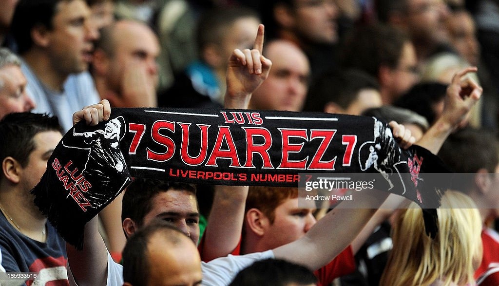 Fans wave flag in support of Luis Suarez during the Barclays Premier League match between Liverpool and West Bromwich Albion at Anfield on October 26, 2013 in Liverpool, England.