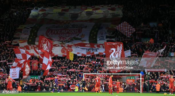 Fans wave flags and banners in The Kop before the Barclays Premier League match between Liverpool and Swansea City at Anfield on February 23 2014 in...