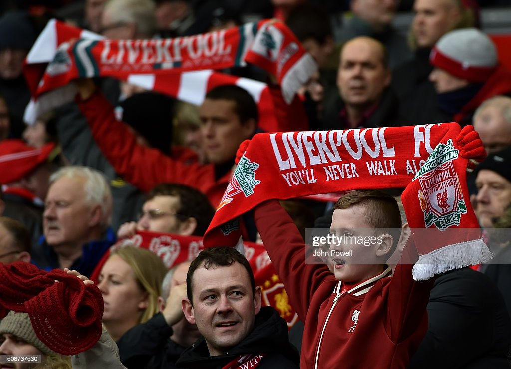 Fans wave flags before the Barclays Premier League match between Liverpool and Sunderland at Anfield on February 6, 2016 in Liverpool, England.