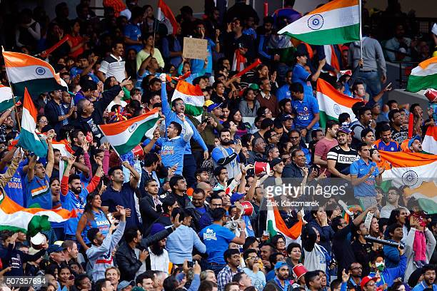 Fans wave flags during the International Twenty20 match between Australia and India at Melbourne Cricket Ground on January 29 2016 in Melbourne...