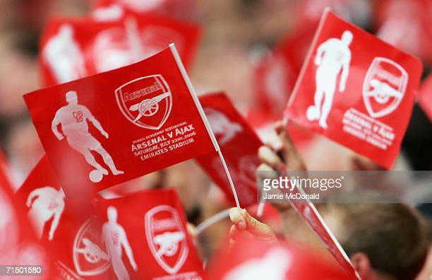 Fans wave flags prior to kickoff during the Dennis Bergkamp testimonial match between Arsenal and Ajax at the Emirates Stadium on July 22 2006 in...