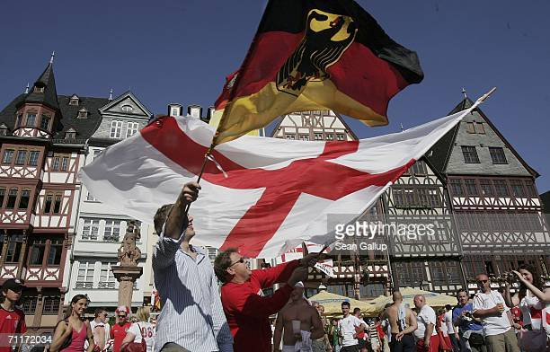 Fans wave German and English flags as they celebrate England's 10 World Cup 2006 victory over Paraguay June 10 2006 in Frankfurt am Main Germany...