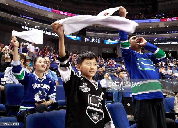 Fans wave rally towels as they cheer during the preseason game between the the Los Angeles Kings and the Vancouver Canucks at the MercedesBenz Arena...