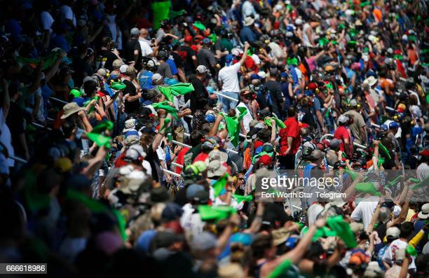 NASCAR fans wave rally towels during the O'Reilly Auto Parts 500 on Sunday April 9 2017 at Texas Motor Speedway in Fort Worth Texas