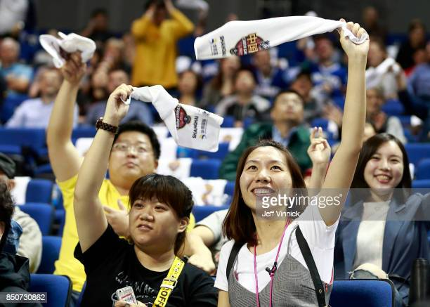 Fans wave rally towels during the preseason game between the the Los Angeles Kings and the Vancouver Canucks at the MercedesBenz Arena September 21...