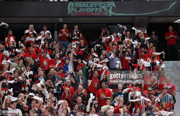 Fans wave rally towels prior to the Ottawa Senators playing against the New York Rangers in Game Two of the Eastern Conference Second Round during...