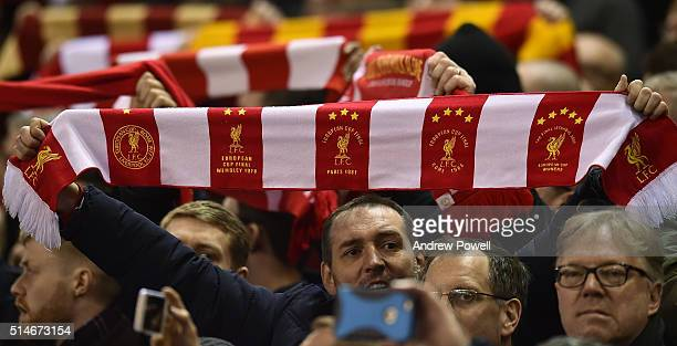 Fans wave scarves and banners before the UEFA Europa League Round of 16 first leg match between Liverpool and Manchester United on March 10 2016 in...