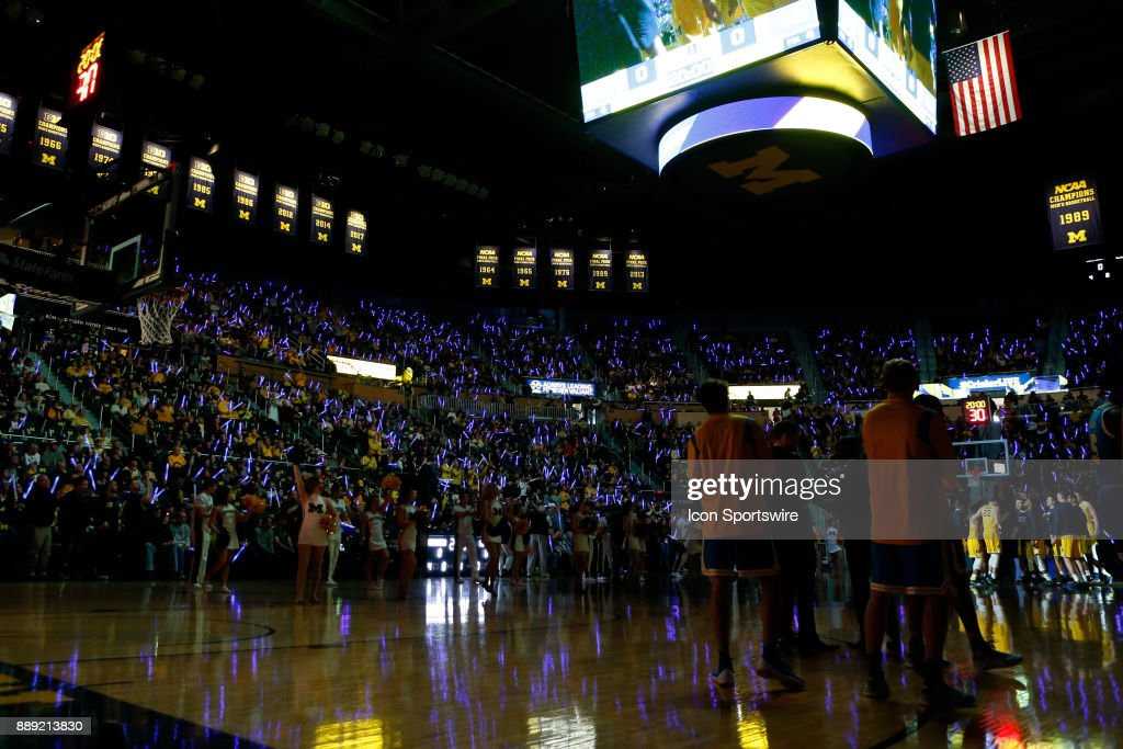 Fans wave Star Wars light sabres during pregame ceremonies before the start of a regular season non-conference basketball game between the UCLA Bruins and the Michigan Wolverines on December 9, 2017 at the Crisler Center in Ann Arbor, Michigan. Michigan defeated UCLA 78-69 in overtime.