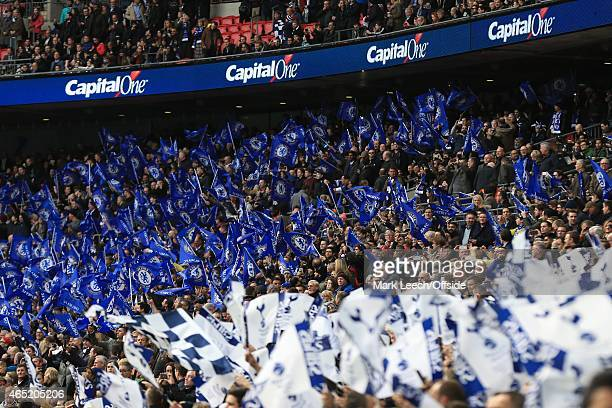 Fans wave the flags provided for them before kick off during the Capital One Cup Final match between Chelsea and Tottenham Hotspur at Wembley Stadium...