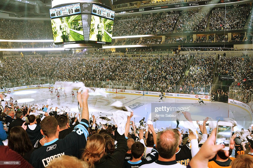Fans wave their towels as the New York Rangers and the Pittsburgh Penguins take the ice for the start of Game Two of the Second Round of the 2014 NHL...