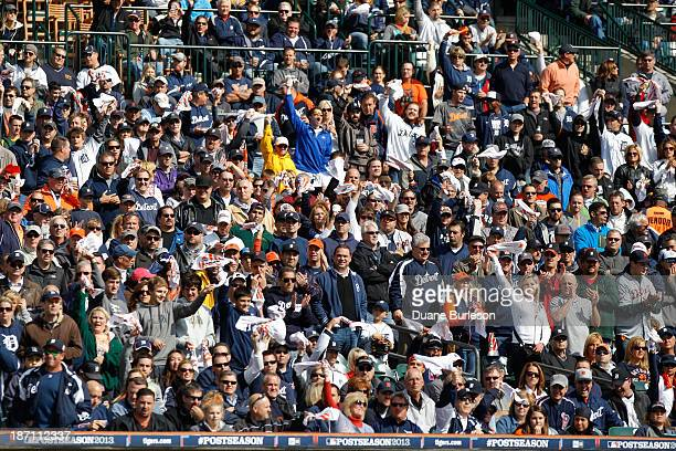Fans wave their towels during Game Three of the American League Division Series on Monday October 7 2013 at Comerica Park in Detroit Michigan