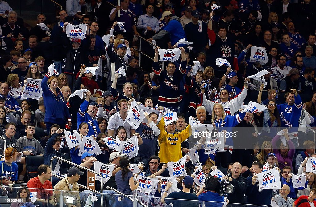 fans wave their towels during the first period in Game Six of the Eastern Conference Quarterfinals between the New York Rangers and Washington Capitals during the 2013 NHL Stanley Cup Playoffs at Madison Square Garden on May 12, 2013 in New York City.